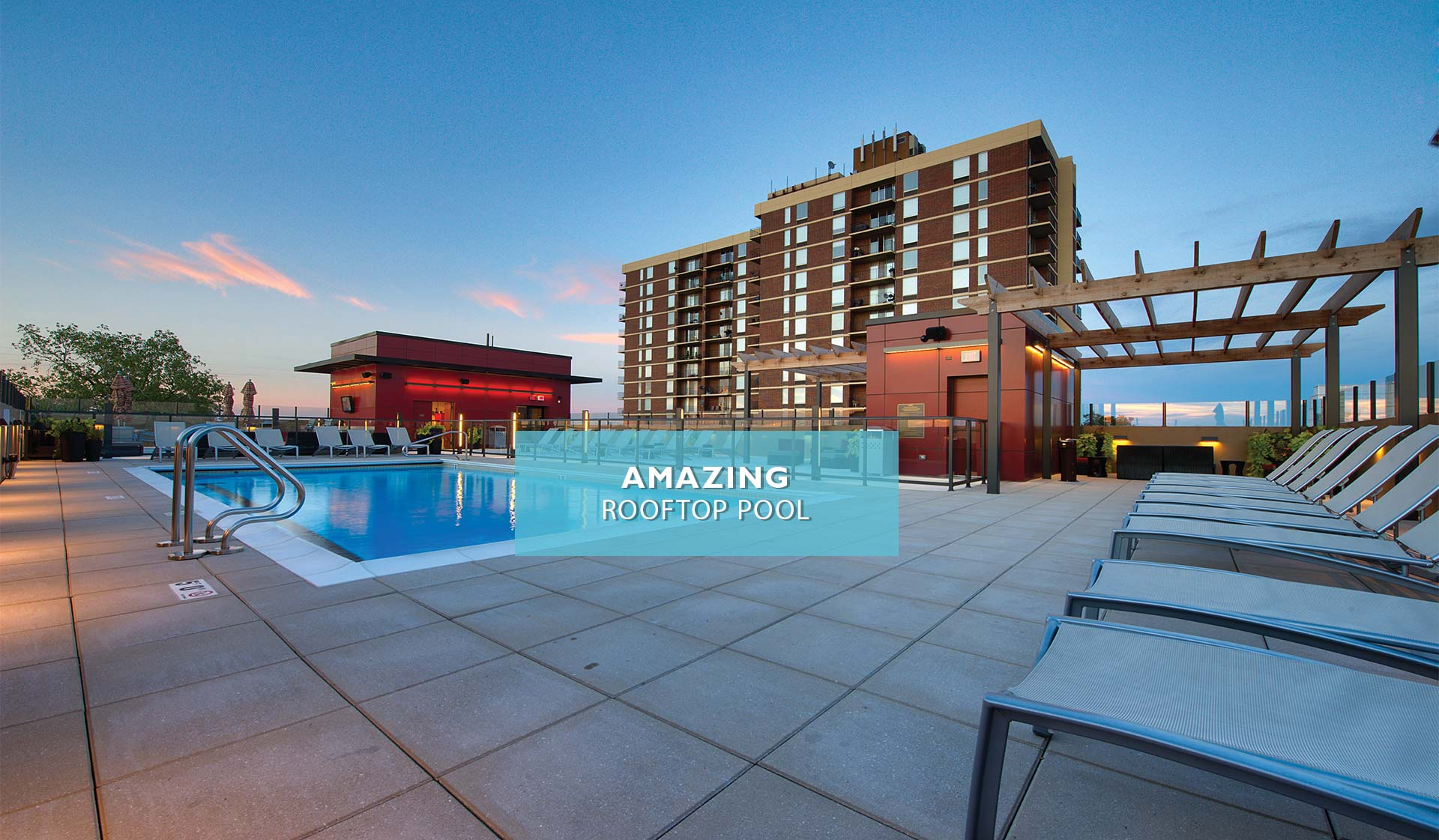 Yorktown Apartment homes - rooftop pool with high-rise building in background - Lombard, IL