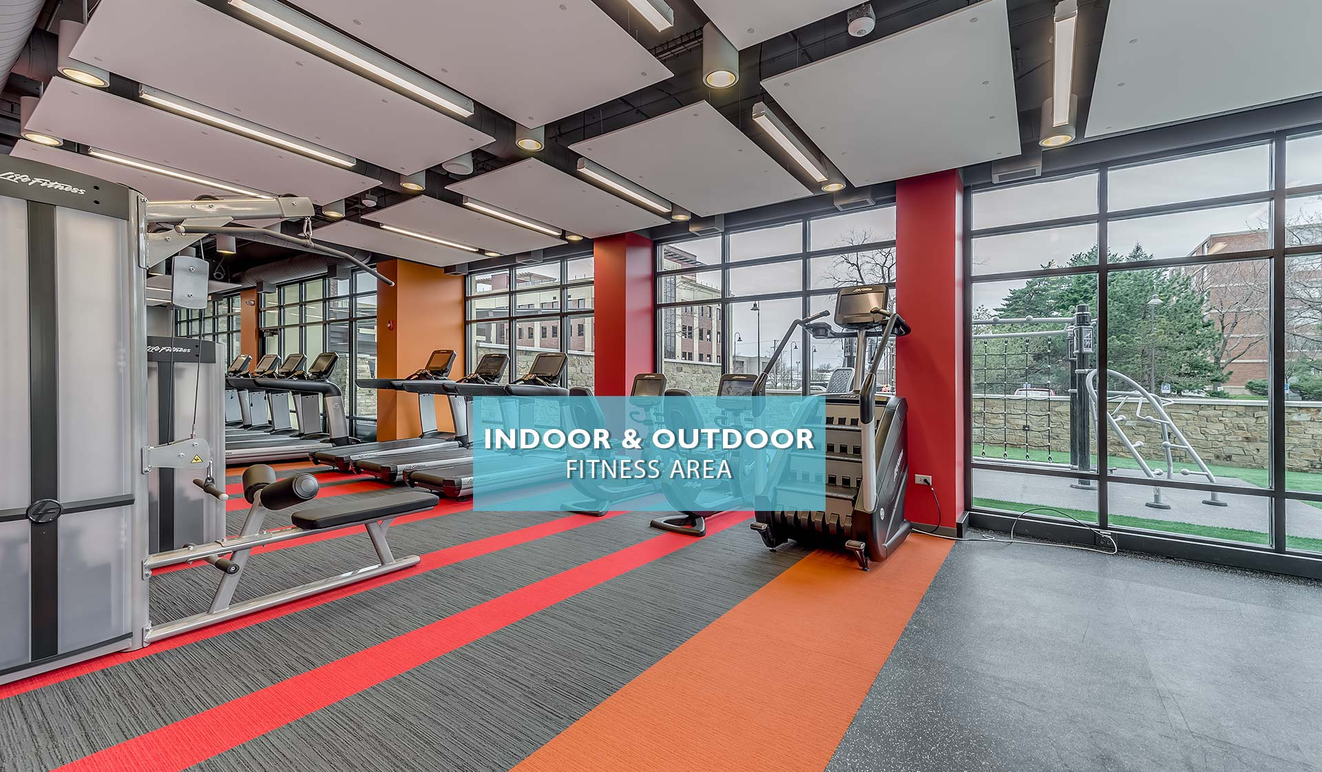 Yorktown Apartment homes - indoor fitness center with weight machines and treadmills - Lombard, IL