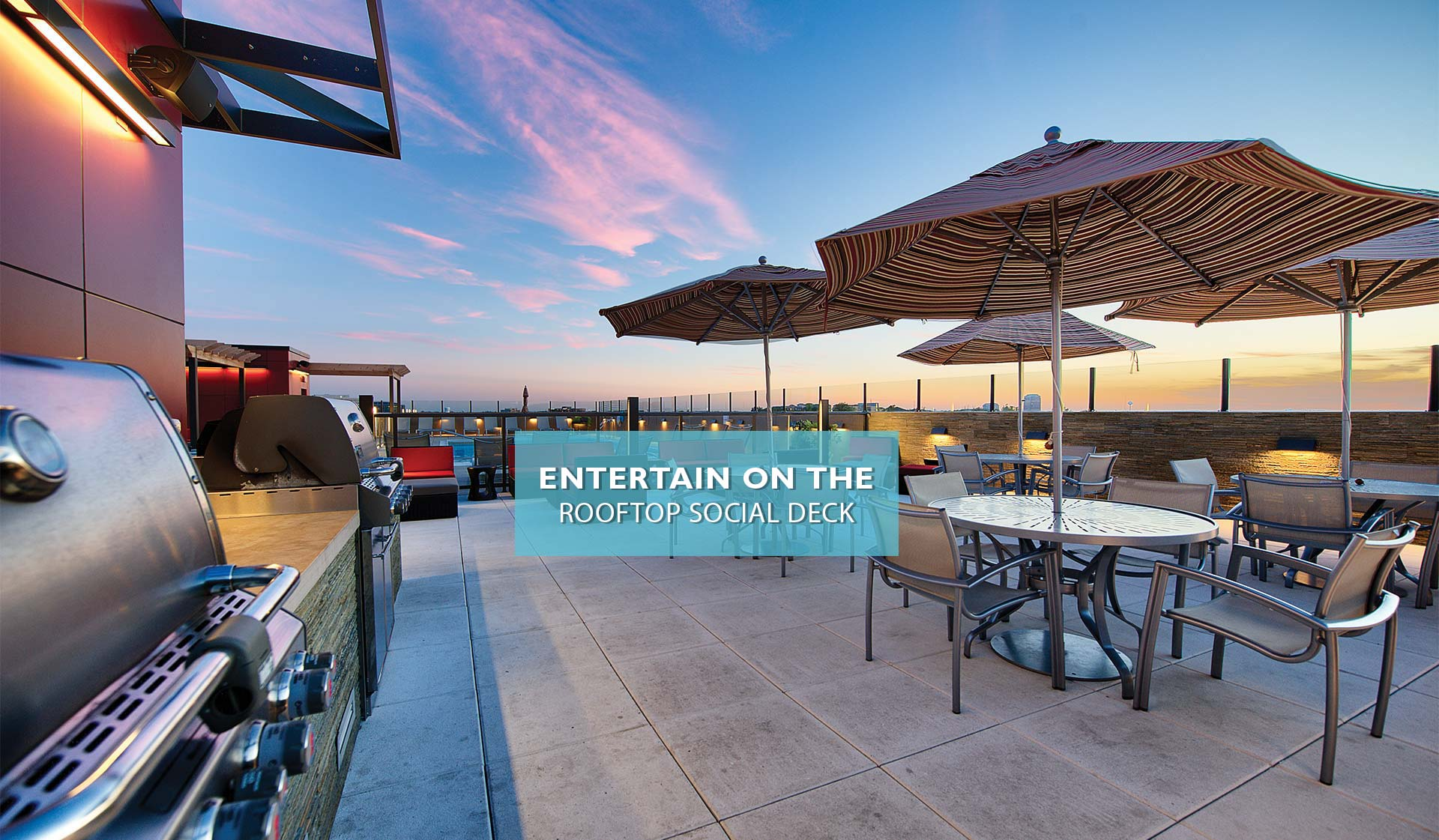 Yorktown Apartment homes - rooftop deck with grill and covered tables and chairs - Lombard, IL